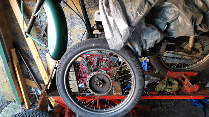 BSA Bantam wheel removed for the spokes to be cutting out and the rims rebuilt by Central Wheel Components