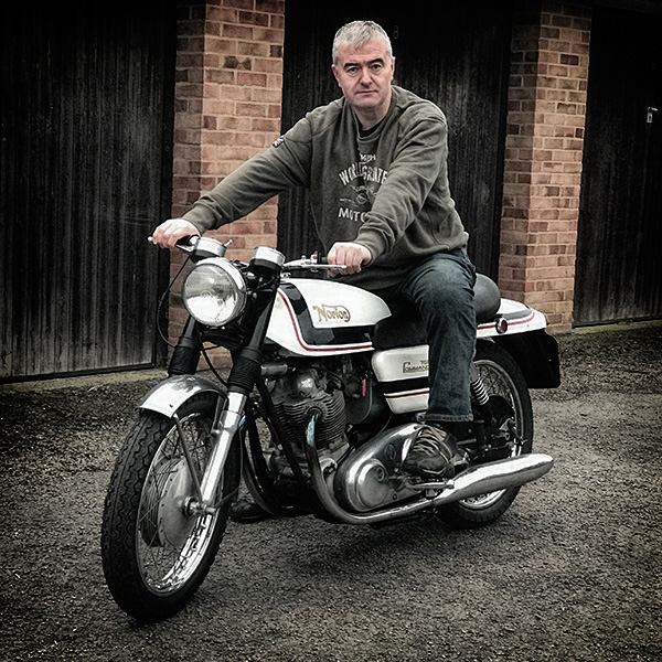 dave clough sitting on his 1969 JPS Norton 750 Commando
